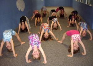 Class of Young Girls Practicing Arches