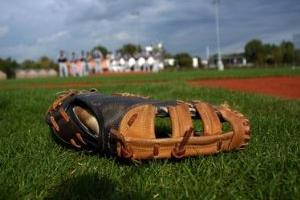 Baseball glove in field.